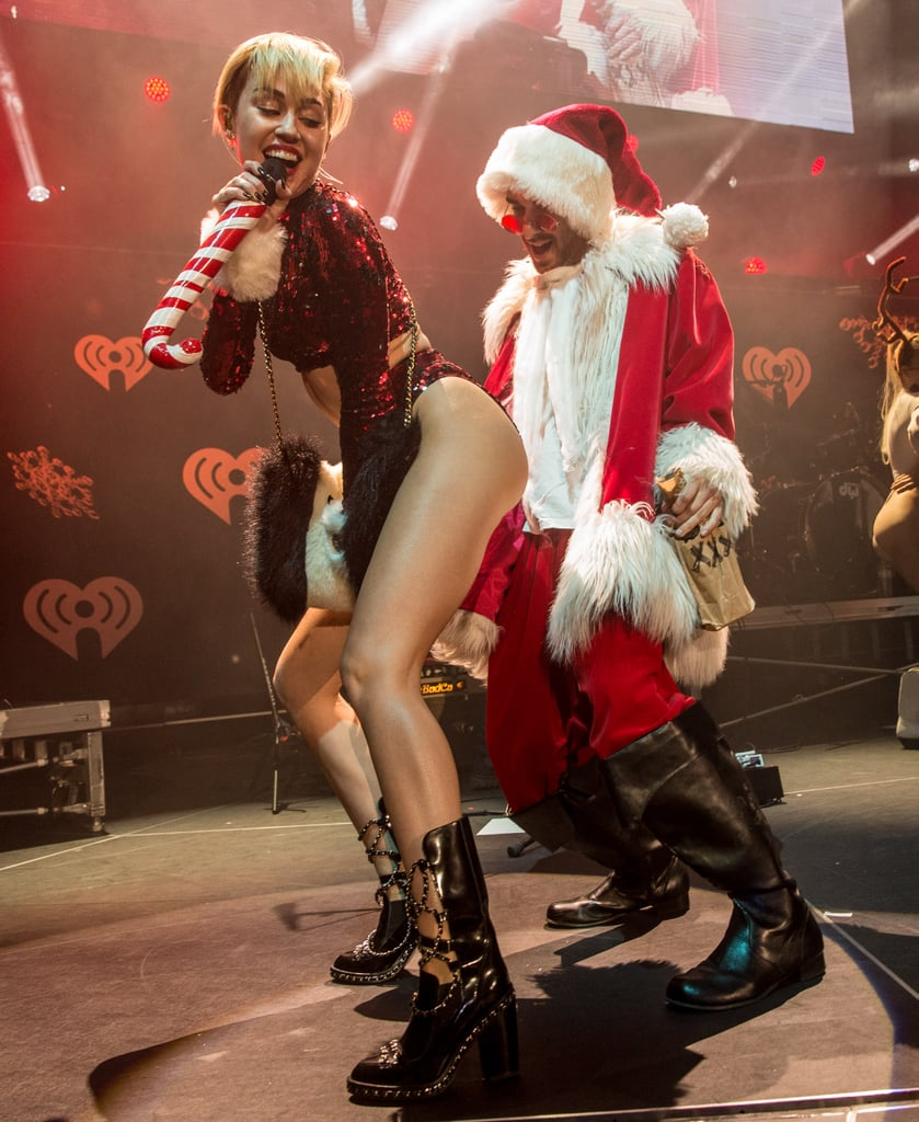 Miley Cyrus took her twerking to the next level at Jingle Ball in LA, trading Robin Thicke for Saint Nick.