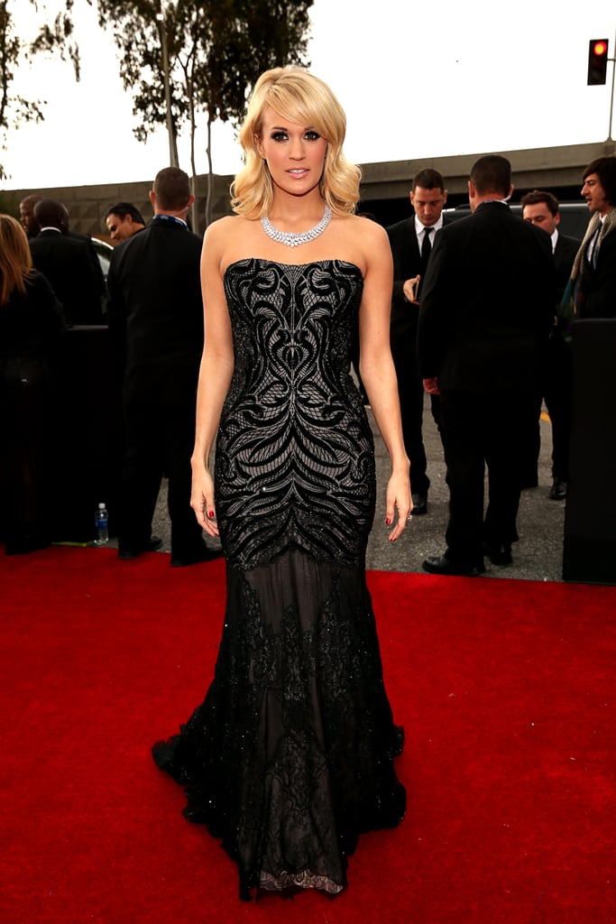Carrie Underwood posed on the Grammys red carpet in a black gown.