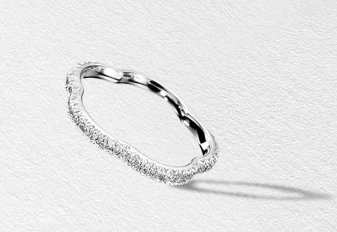 Chanel's Camélia wedding band (inquire for price) is quintessential Chanel, done up in the iconic camellia flower shape and stunning in its finish.