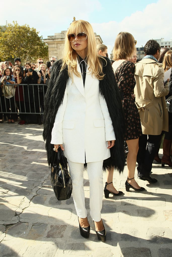 Rachel Zoe draped a black coat over her ensemble.