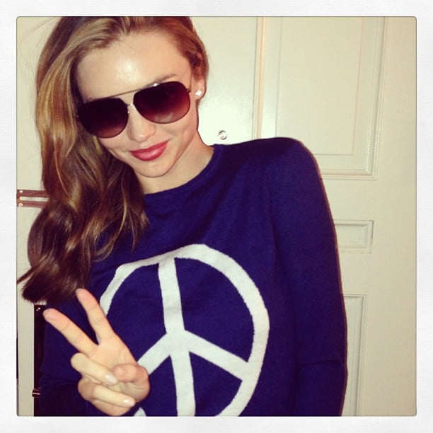 Miranda Kerr flashed a peace sign (while sporting a peace sign sweatshirt). Source: Instagram user mirandakerr