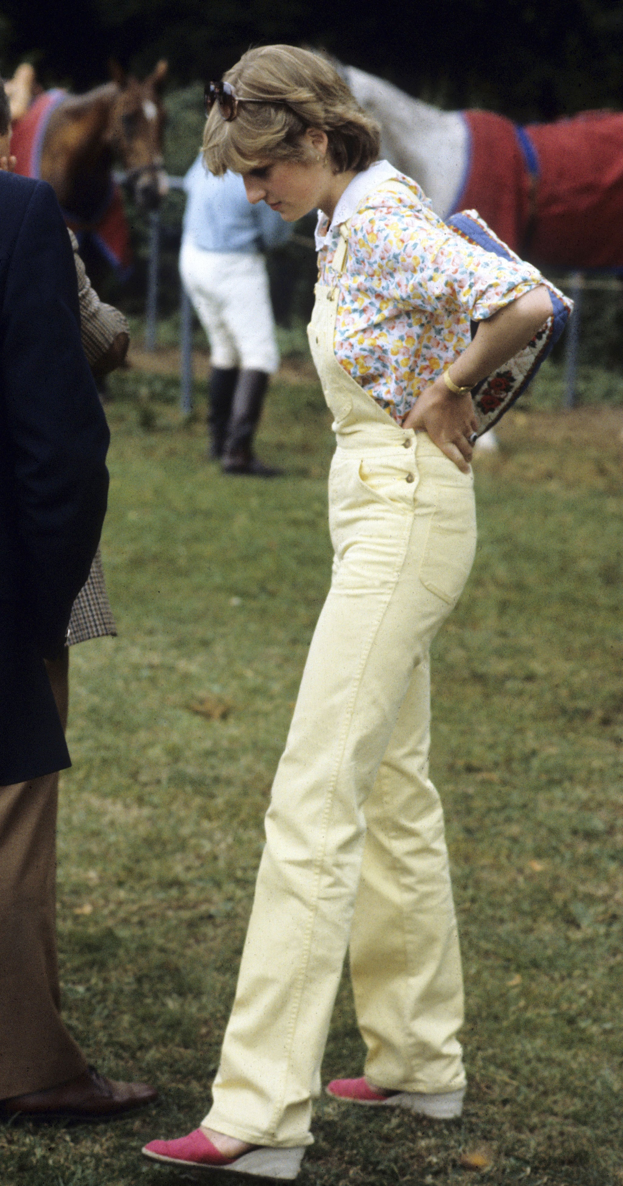Of course, when she wanted to slip into something more functional, Princess Diana wore pants like a pro — and we love the way she paired her overalls with a floral collared blouse and wedges. We'd slip into this look, no problem. Source: Getty/Anwar Hussein
