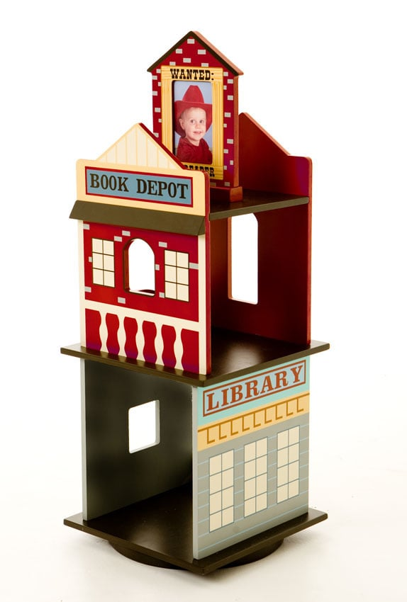 Collect all his books in a Levels of Discovery Wild West revolving bookshelf ($175, originally $195) that features a rustic town design. And it's topped with an adorable picture frame for popping in a shot of your little fugitive.