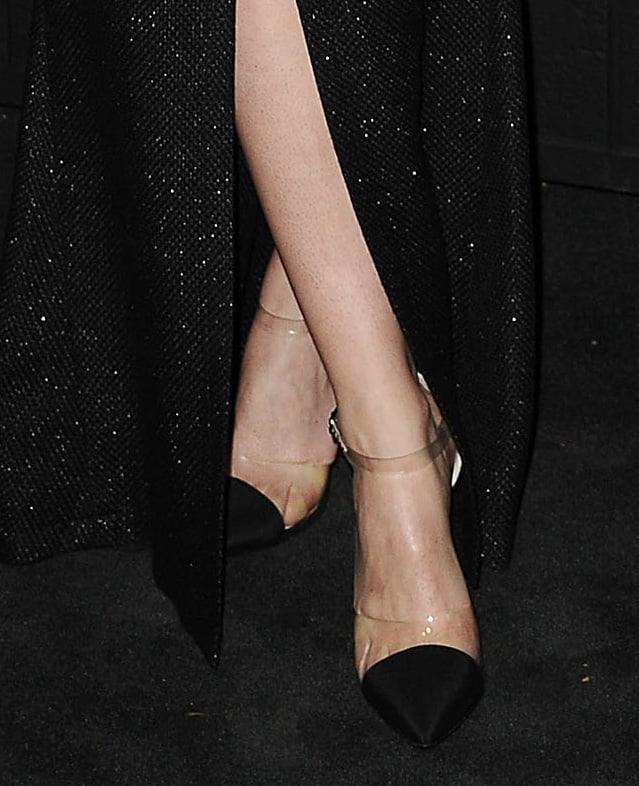 She paired her black-and-white Chanel dress with PVC-infused Chanel pumps.