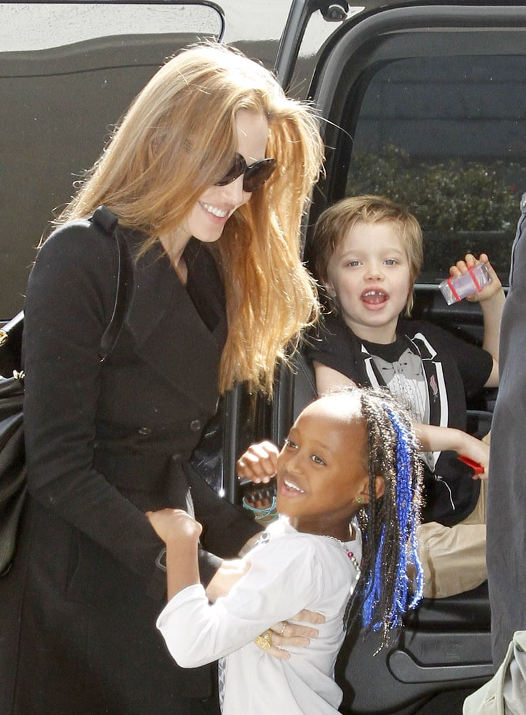 Angelina Jolie helped Shiloh and Zahara Jolie-Pitt out of a car at LAX in March.