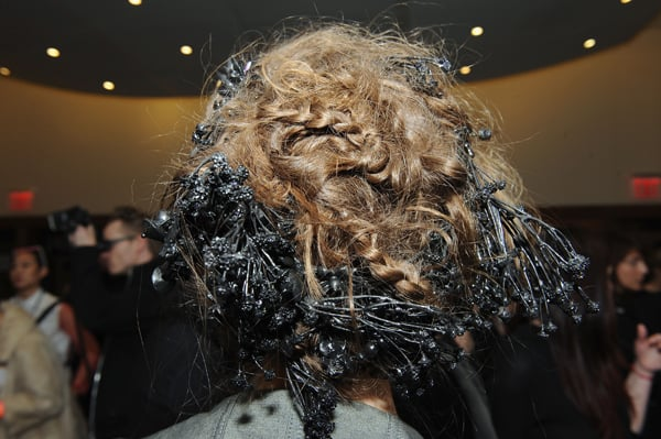 The braided and twisted hair featured handmade rubberized accessories, along with a small dusting of glitter.