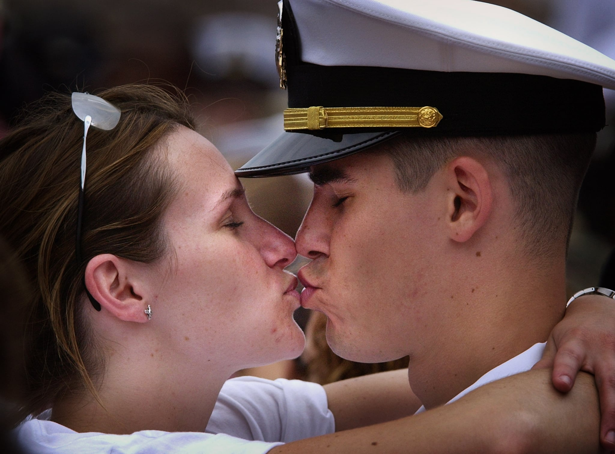 Erin Doherty gives boyfriend Warren Van Allen a kiss pier-side after the US Navy aircraft carrier USS Theodore Roosevelt returned home to Norfolk Naval Station May 29, 2003.
