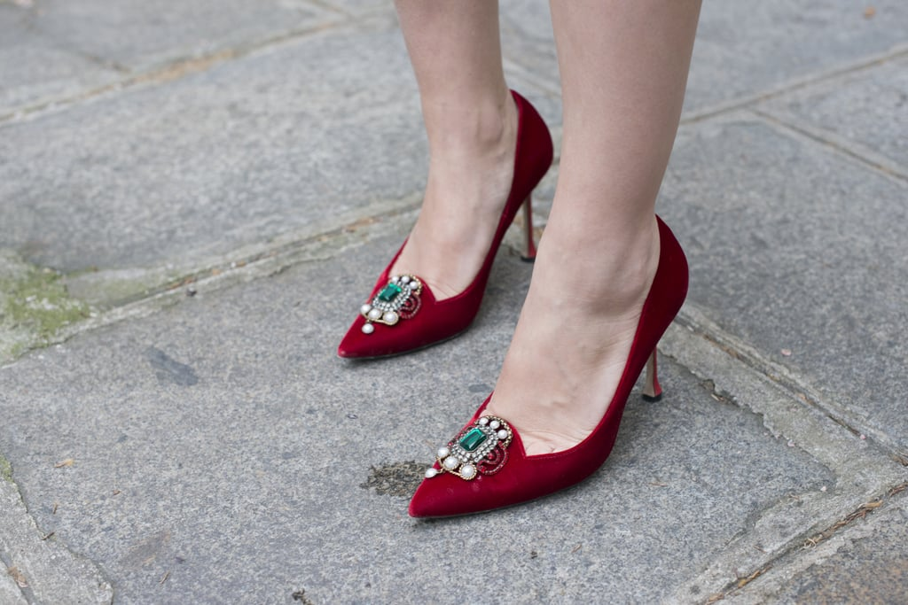 Red shoe wonders, complete with a little embellishment.