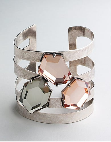 We love the soft tones of the jewels on this; it's a bold piece, but not in an obvious way.  BCBgeneration Open Metal Stone Cuff Bracelet ($48)