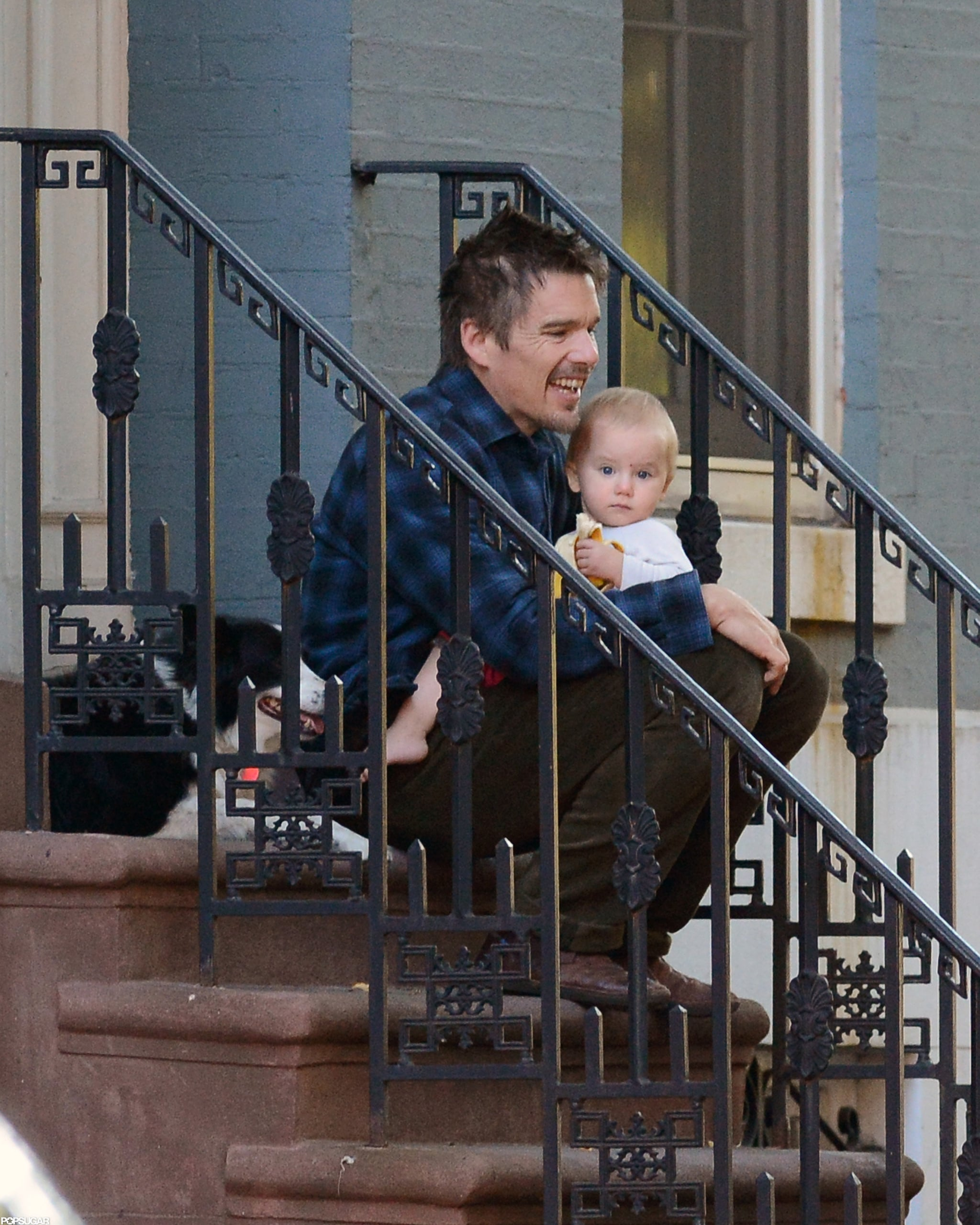 Ethan Hawke sat with his youngest child outside in NYC.