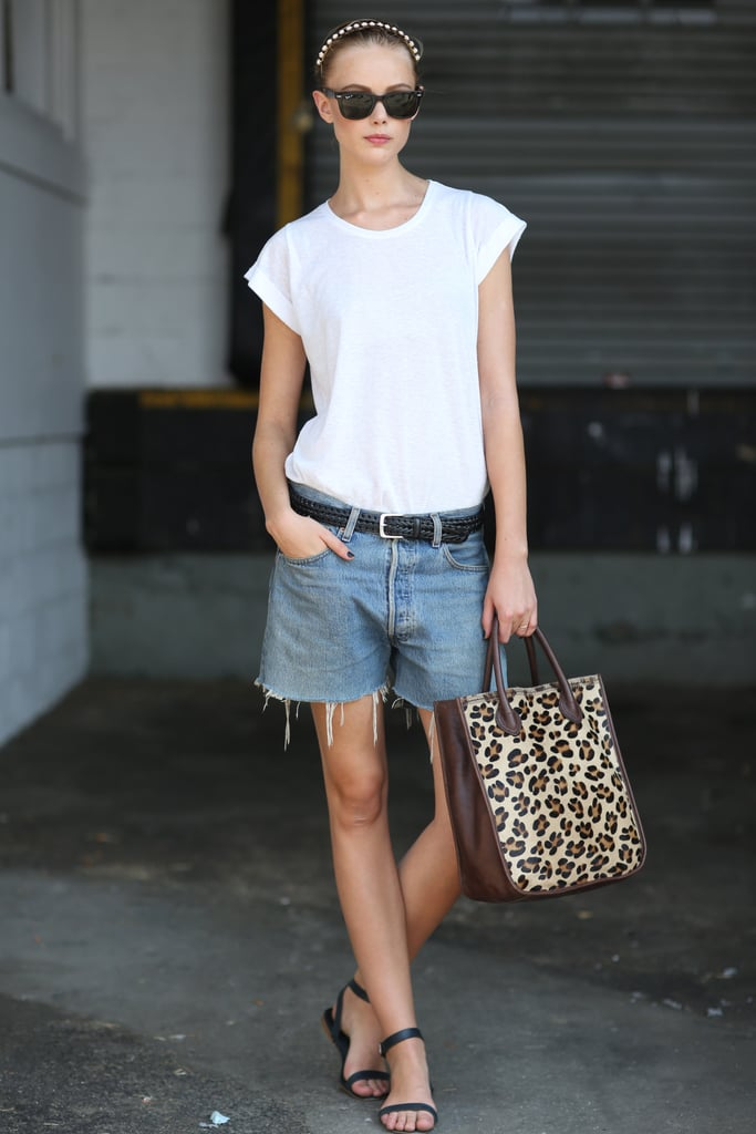 Simple, but chic — all this styler needed was a leopard-print tote to offset her basics. Source: Greg Kessler