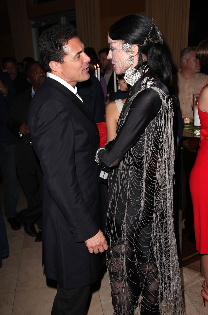 Daphne Guinness Trades in Skunk-Striped Hair for All Black, Swims in Pool Clothed for Art Basel Performance Piece