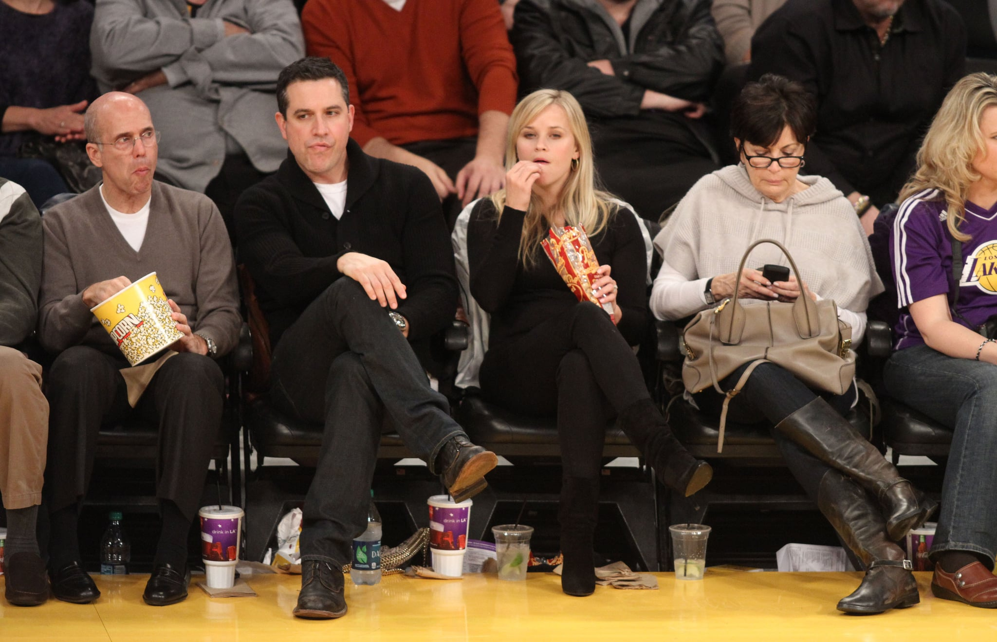 Reese Witherspoon and her husband, Jim Toth, went to the Lakers game.