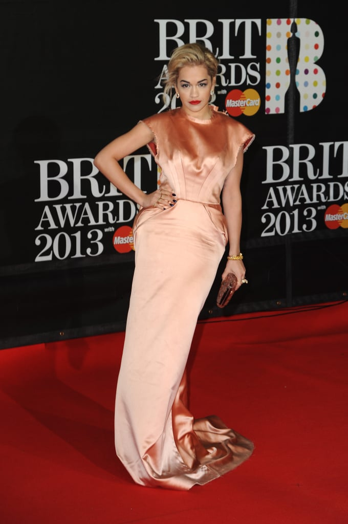 Rita Ora wore a stunning peach gown to the Brit Awards in London.