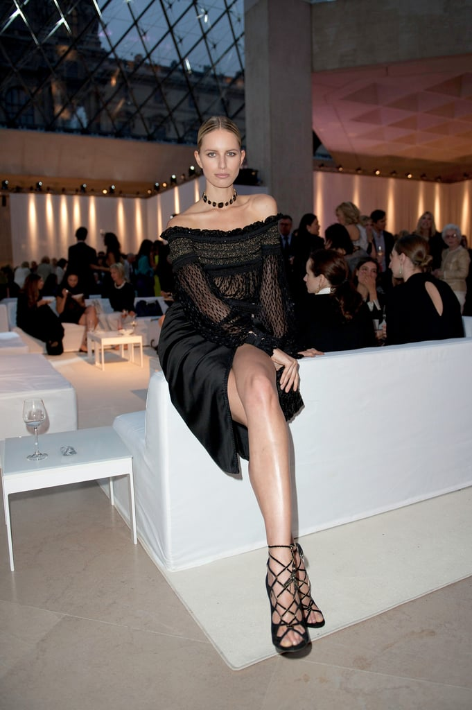 Karolina Kurkova made herself comfortable on the couches at the Salvatore Ferragamo Resort collection show in Paris.