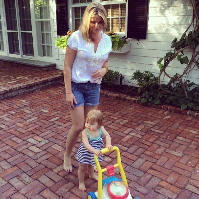 Mila Hager practiced her walking skills (and lawn mowing) with her mom, Jenna Bush Hager, trailing behind. Source: Instagram user jennabhager