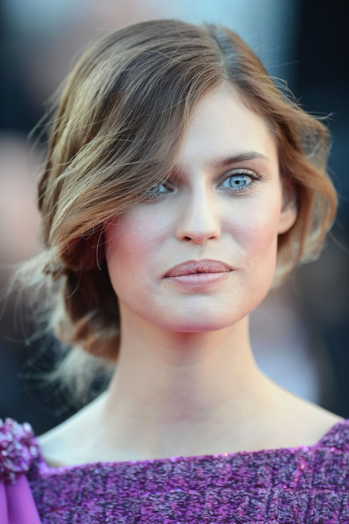 Bianca Balti joined her model friends at the Immigrant premiere wearing a soft updo with a wavy texture, and her makeup featured the slightest flush of pink on cheeks and lips.