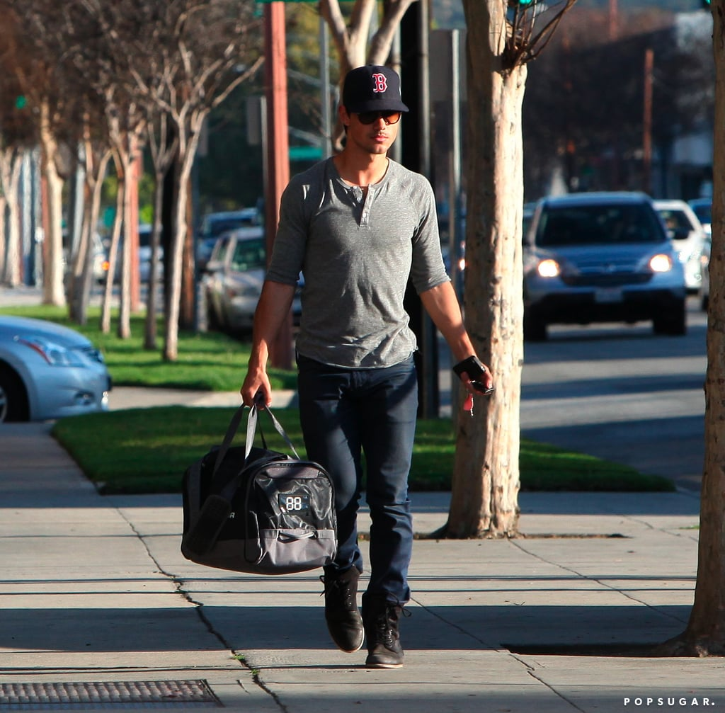 Taylor Lautner had a bag in hand.