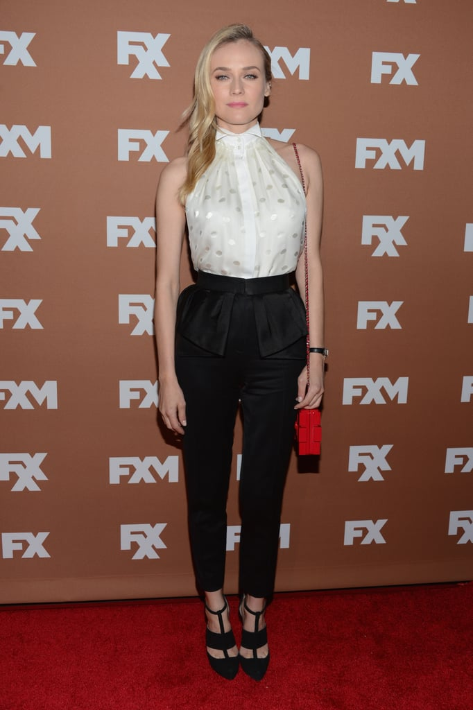 """Diane """"Wu-ed"""" us in a perfectly constructed pairing: white collared Jason Wu blouse and peplum-detailed black trousers, at an FX upfront bowling event earlier this year. Her strappy black pumps and red mini Chanel bag were the icing on this fashion-forward look."""