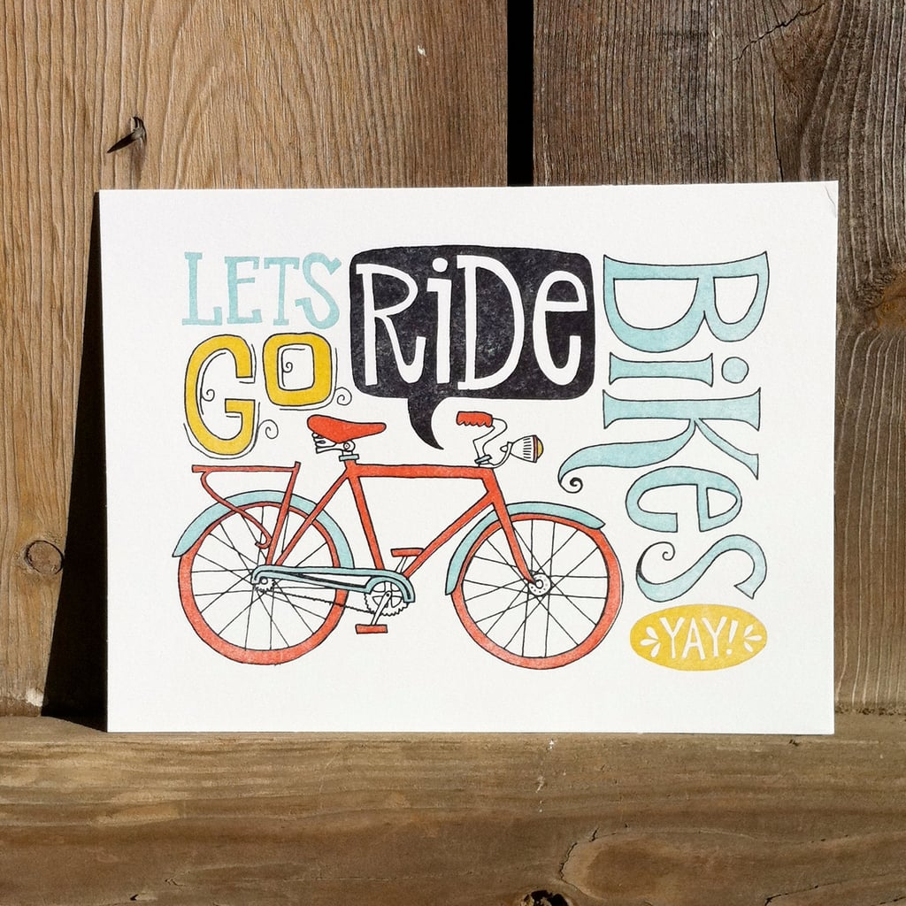 """It's the new phrase you'll be hearing a lot! Hang the """"let's go ride bikes"""" letterpress print ($32) in your child's room for a fun reminder."""