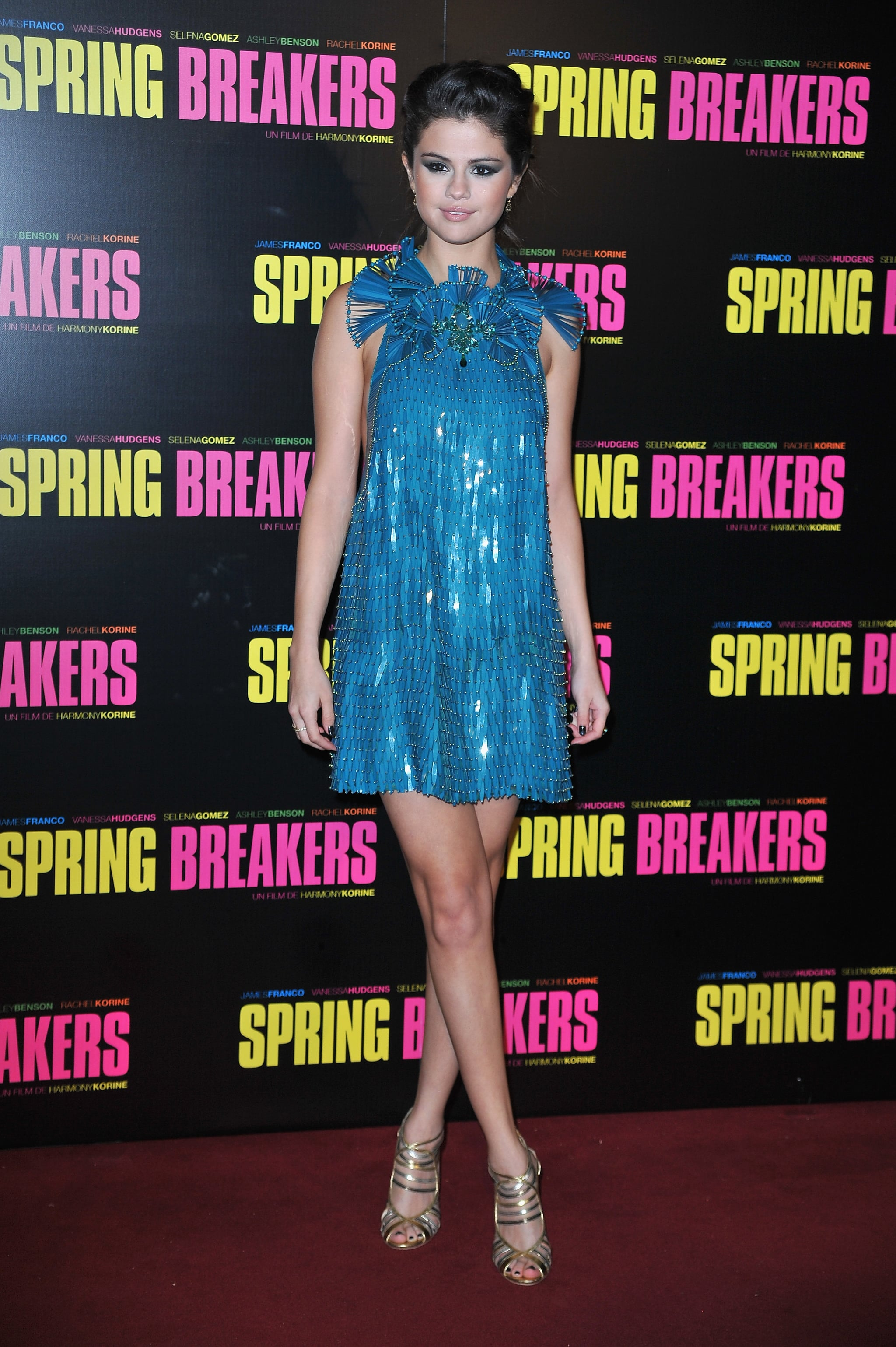 Selena Gomez was all about glitz and glamour in her blue studded Gucci minidress and gold caged Jimmy Choo sandals at the Paris premiere of Spring Breakers.