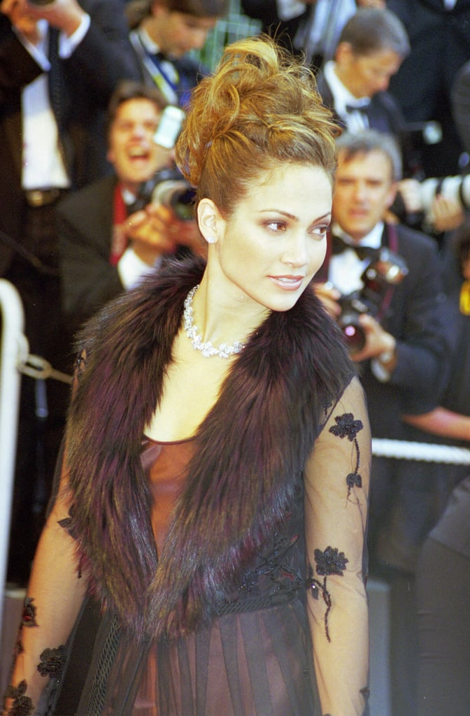 Jennifer Lopez wore a fur collared dress to the 51st Cannes Film Festival in 1998.