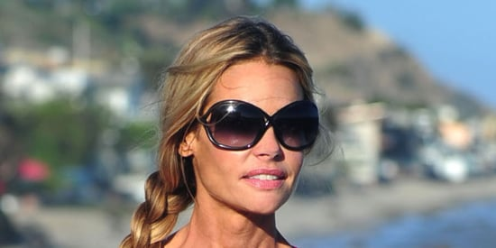 Denise Richards Hits The Beach In A Neon Pink Bikini