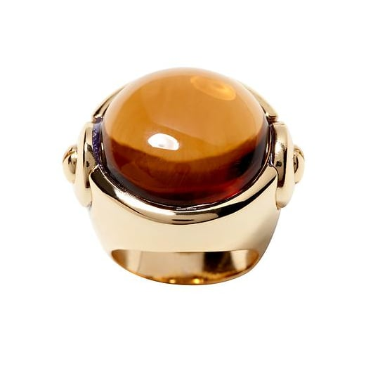 The amber stone is warming and neutral and would be an eye-catching finishing touch to solid or print maxi dresses. Banana Republic Tribal Cocktail Ring ($50)
