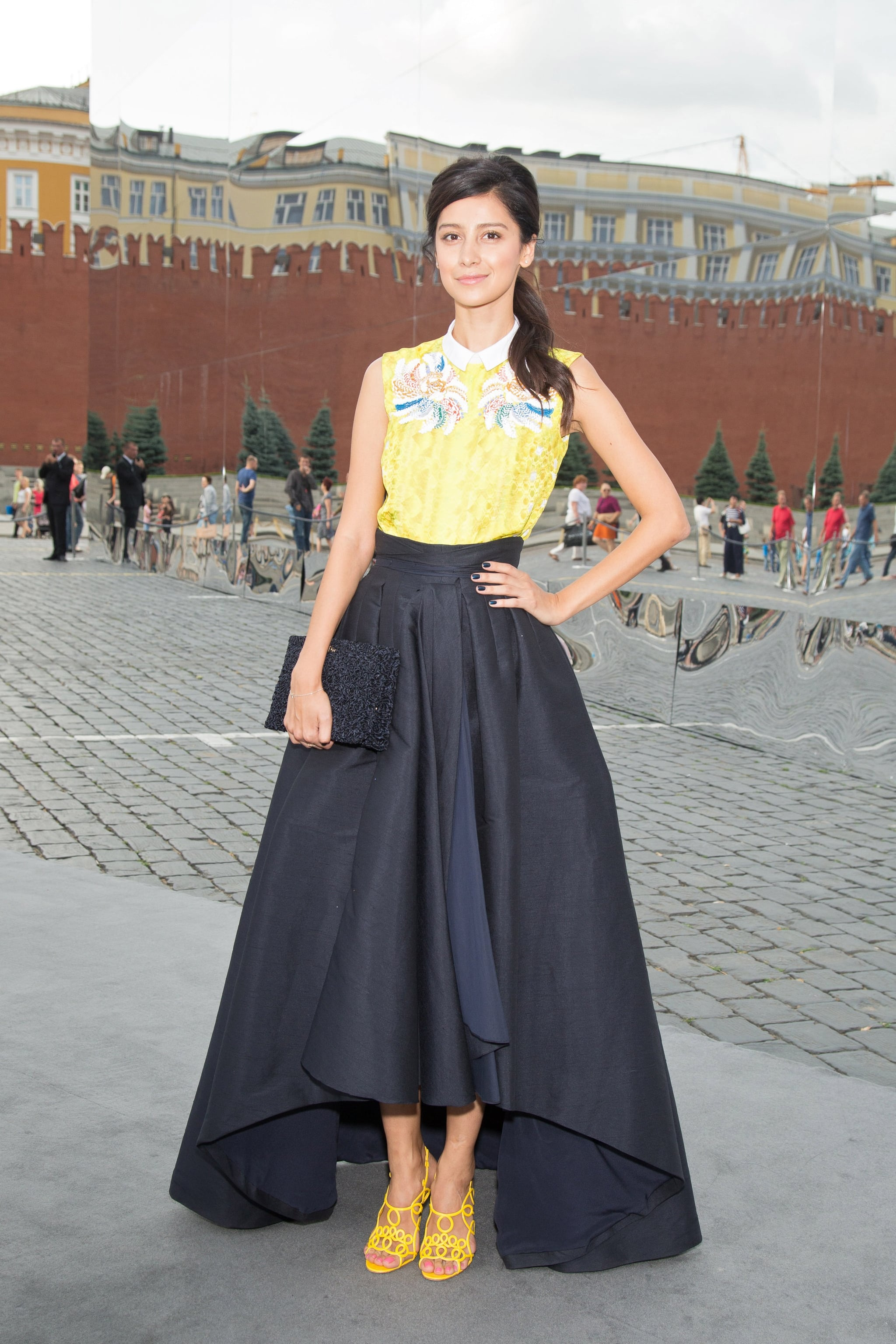 Ravshana Kurkova stood out from the crowd with bold pops of yellow while en route to Christian Dior.