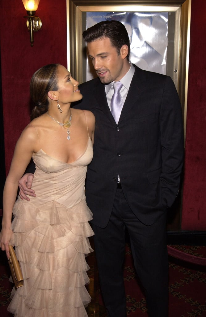 Jen couldn't take her eyes off of her man as they attended the NYC premiere of her movie Maid in Manhattan in December 2002.