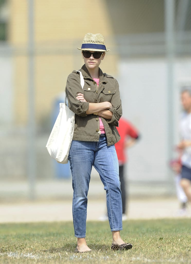 Sideline style: fedora, anorak, boyfriend jeans, and leopard flats.