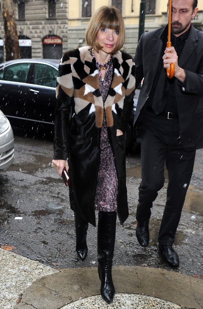 On her way into Dolce & Gabbana, Anna Wintour bundled up ever-so-chicly in a printed dress, multicolored fur coat, and black knee-high boots.