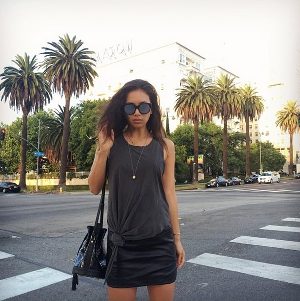 In the Summer, tying a knot in a baggy tee is a go-to style trick. Up the fancy factor with layered jewelry and a statement satchel. Source: Instagram user rumineely