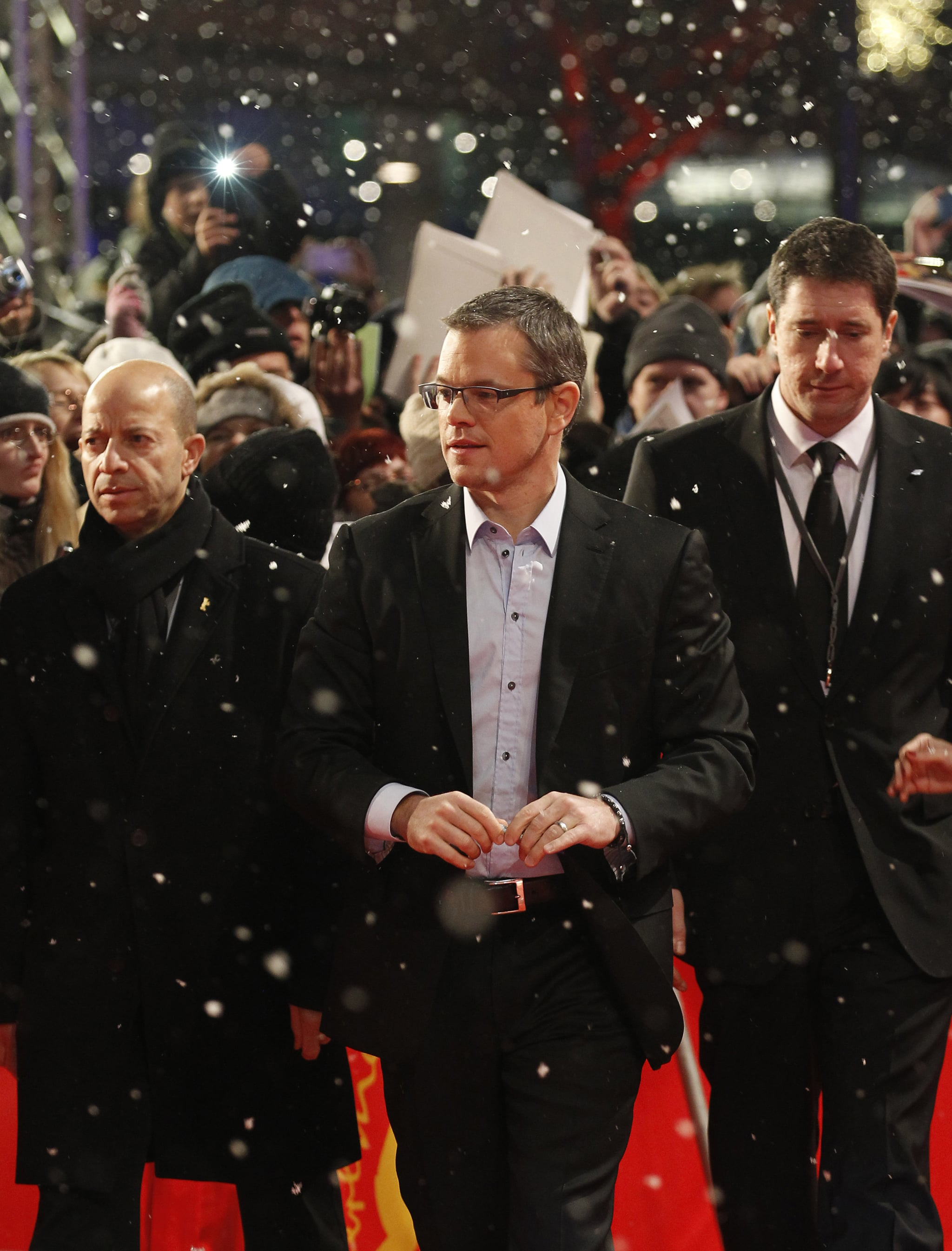 Matt Damon arrived at the Berlin premiere of Promised Land Friday night while it was snowing.