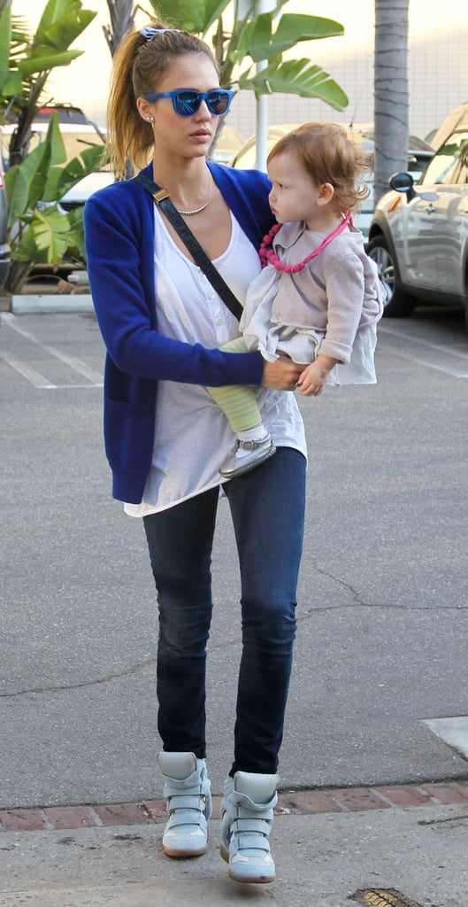 Jessica beat the Winter blues in a cobalt sweater, matching mirrored shades, a navy bag by Vince Camuto, and baby blue Isabel Marant sneakers in LA.