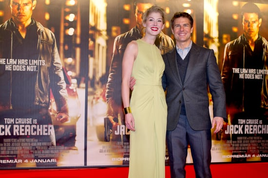 Tom Cruise and Rosamund Pike flashed smiles.