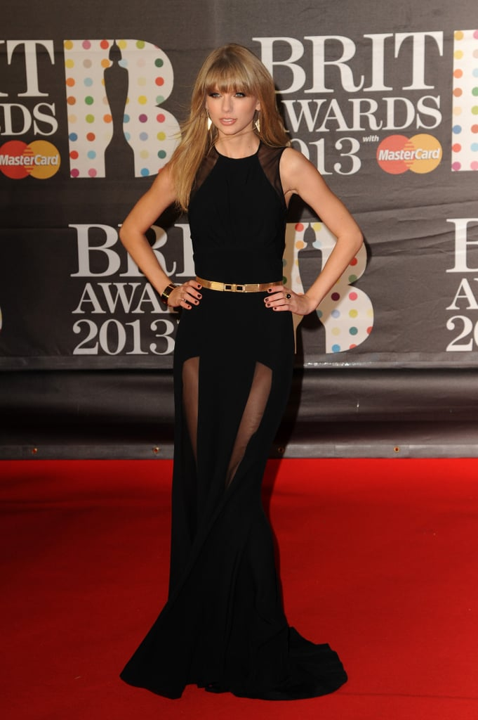 Taylor Swift channelled her darker side in a black sleeveless Elie Saab gown with a sheer skirt and shoulder panels, and a gold metallic belt to accentuate her waist.