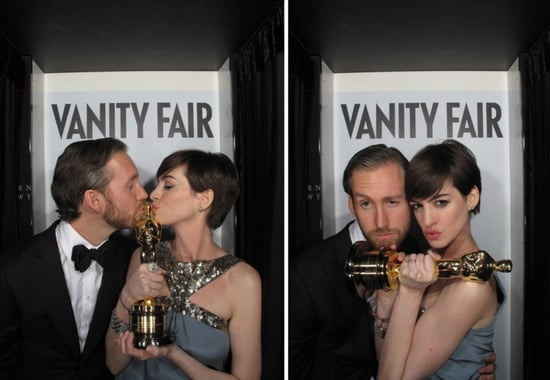 Anne Hathaway and Adam Shulman posed in Vanity Fair's Oscars party photo booth.