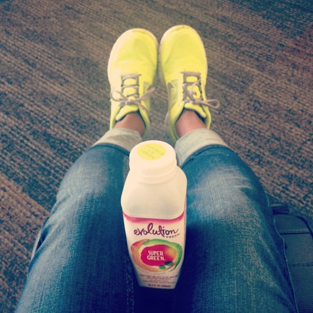 Chilling out at the airport with cold-pressed juice and highlighter-hued sneakers. Source: Instagram user brittsteps