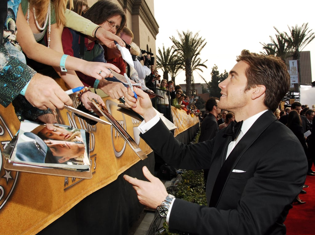 Jake stopped to sign autographs for fans in the bleachers at the Screen Actors Guild Awards in January 2006.