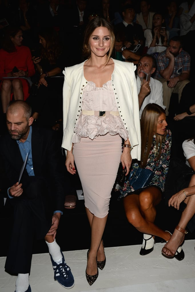 Olivia Palermo was prim and proper in a frilly soft pink top and a matching pencil skirt at the Nina Ricci show. She then threw on a white jacket and printed Stuart Weitzman pumps to complete her front-row style.