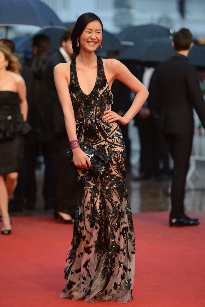 Model Liu Wen wore a black and nude embellished halter-style gown to the Amour premiere.