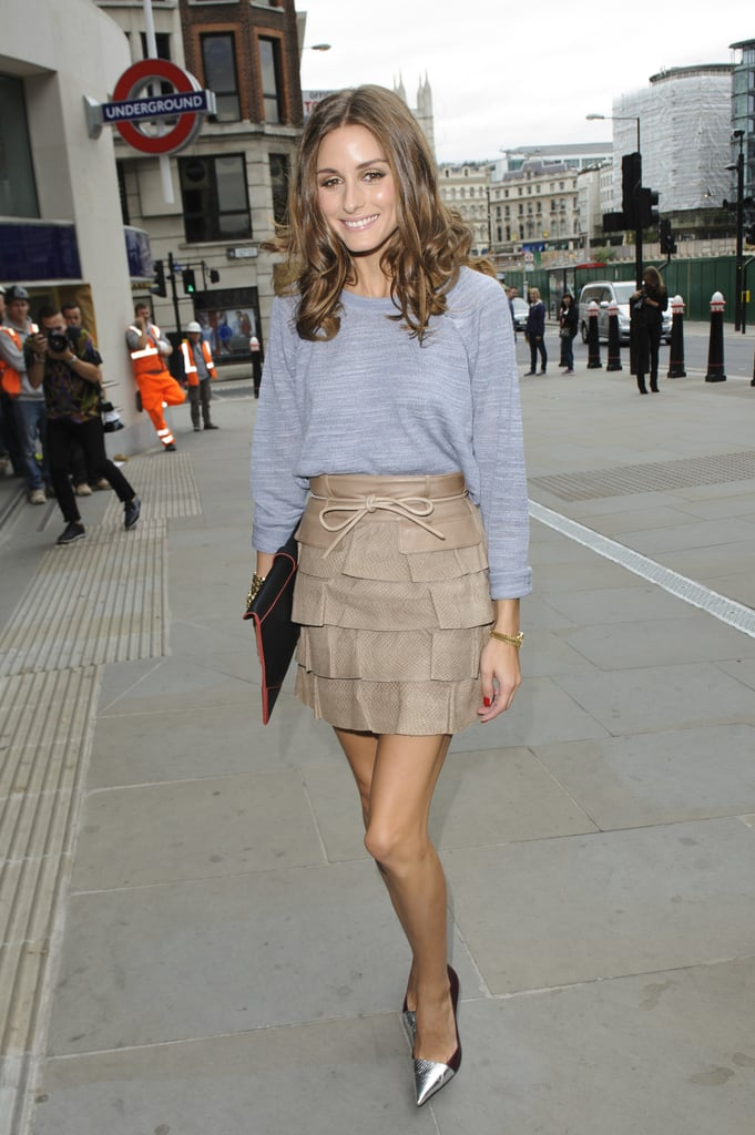 Olivia gave a Reiss basic knit a fashion-forward twist with a tiered Matthew Williamson miniskirt and a pair of metallic cap-toe pumps by Elizabeth and James at the Matthew Williamson show in London. 8761925
