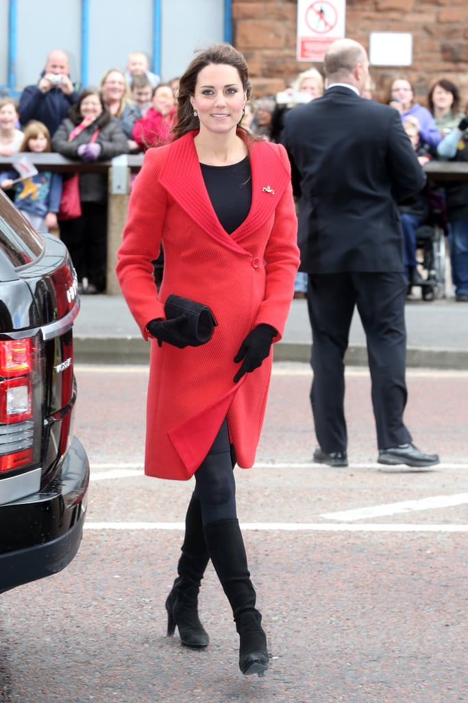 Kate Middleton stepped out in Scotland and looked the royal part in a statement red coat by Armani.