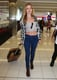 """The art of wearing a crop top at the airport, as illustrated by Georgia May Jagger: stay covered up on the bottom, as she did with classic jeans and boots. Like Georgia, you want your look to say """"'90s cool girl,"""" not """"working girl."""" An added layer like a button-down or anorak offers a little insurance against the AC — and against any unwanted attention. The bonus: TSA can plainly see you're not hiding any liquids or gels."""