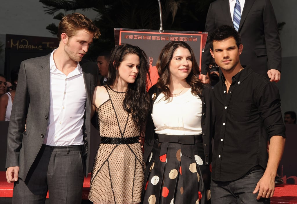 Robert Pattinson, Kristen Stewart, and Taylor Lautner posed with the author of the Twilight series, Stephenie Meyer.
