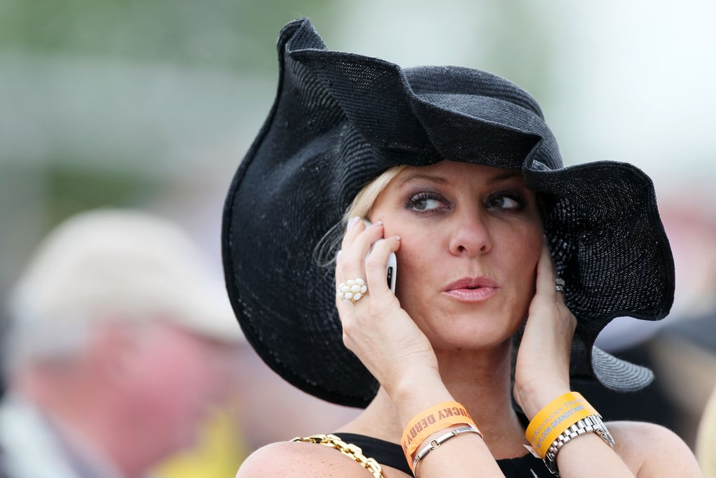 In 2010, a woman chatted on her phone while wearing her crinkly hat.