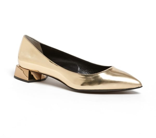 Artsy types will adore the sculptural heel detail on these Fendi slippers ($750).