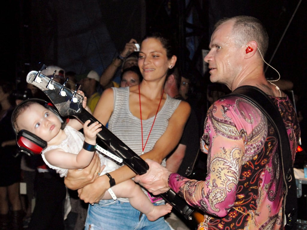 "Frankie Rayder and her husband, Michael ""Flea"" Balzary, the bassist for the Red Hot Chili Peppers, have been married since 2005. In this picture from Lollapalooza in 2006, Rayder is seen holding their daughter, Sunny."