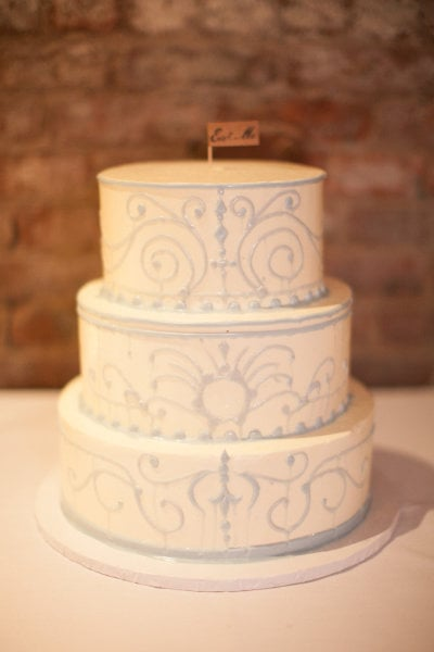 """One cake ditched the standard cake topper for a tiny """"eat me"""" flag. Photo by  Bryce Covey Photography  via Style Me Pretty"""